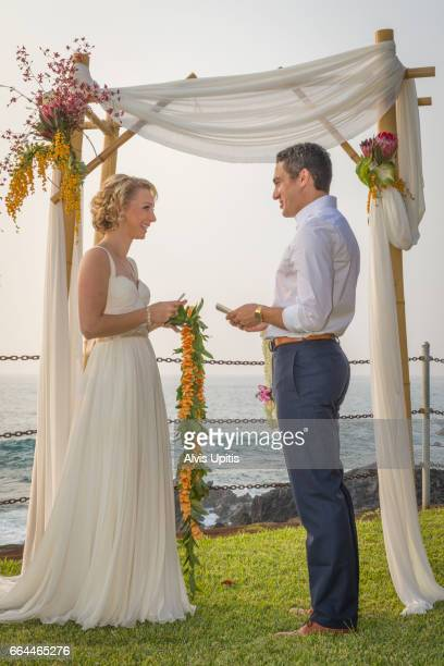 Couple exchanging wedding vows oceanside in Hawaii