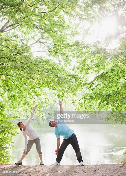 Couple exercising near lake