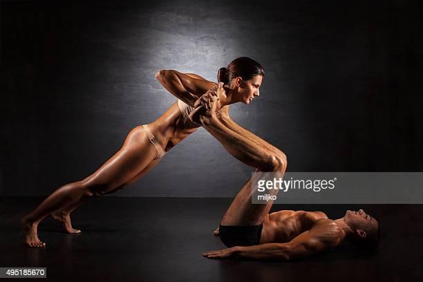 Couple exercising push ups