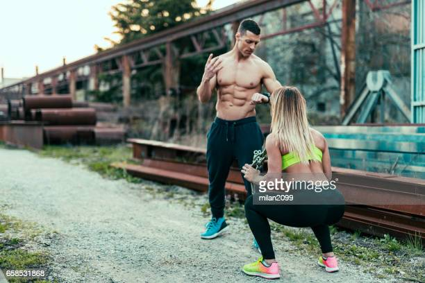 Couple exercising squats