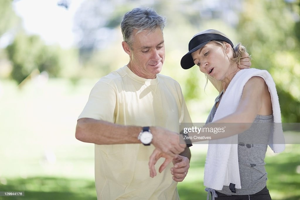 Couple exercising together outdoors : Stock Photo