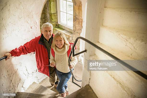 Couple explore Bolton Castle, a 14th century Grade I listed building and a Scheduled Ancient Monument.