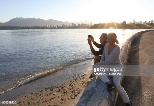 Couple explore waterfront area of city, sunrise