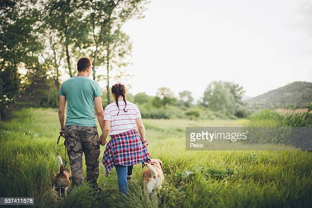 Couple exploring forest with their dogs