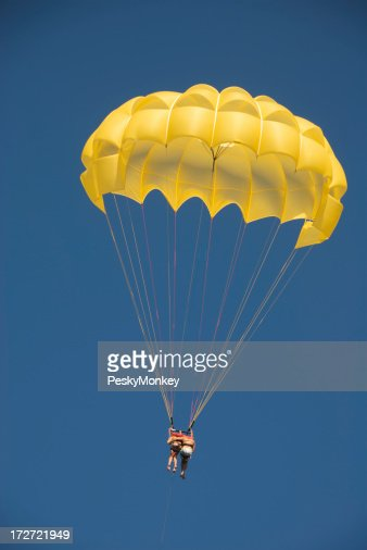 Couple Falling Together in Yellow Parachute Blue Sky