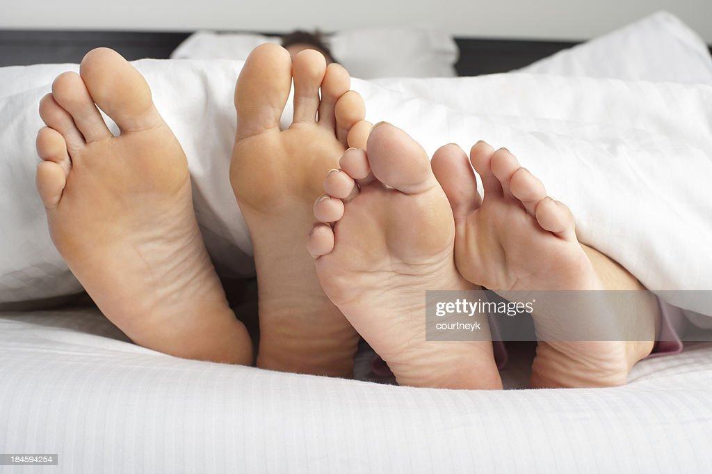 Couple feet poking out : Stock Photo