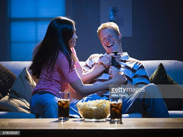 Couple fighting over television remote
