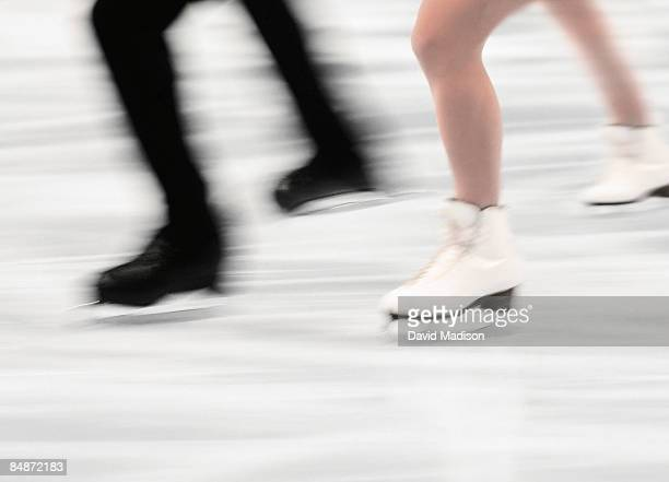 Couple figure skating in competition.