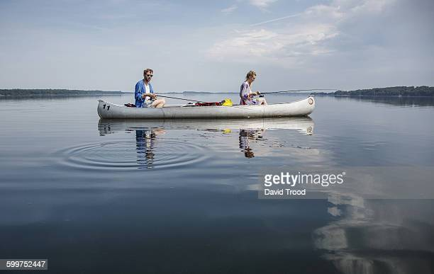 Couple fishing on a calm lake.