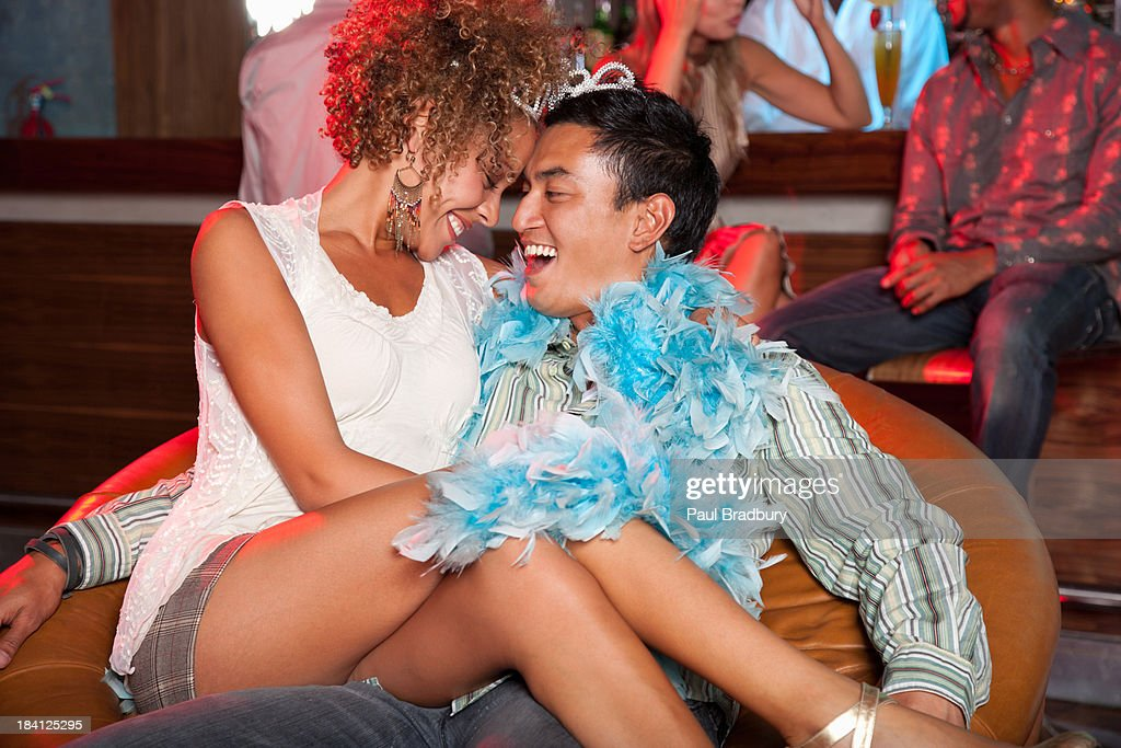 A couple flirting at a bar : Stock Photo