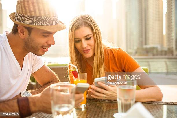 couple flirting at cafe in dubai marina