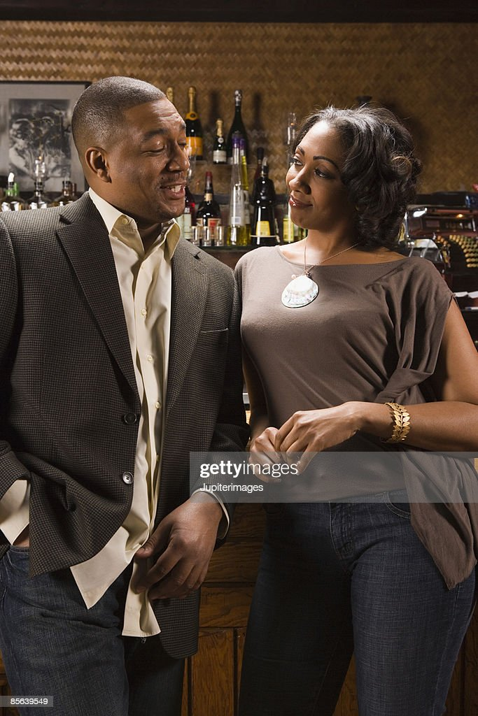 Couple flirting in bar : Stock Photo