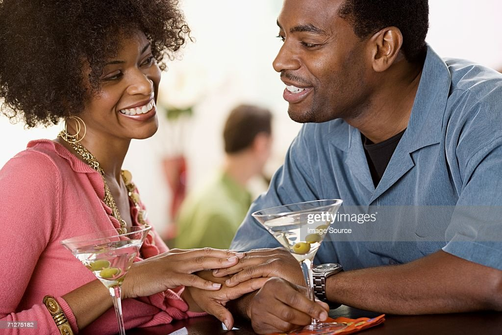 Couple flirting over cocktails : Stock Photo