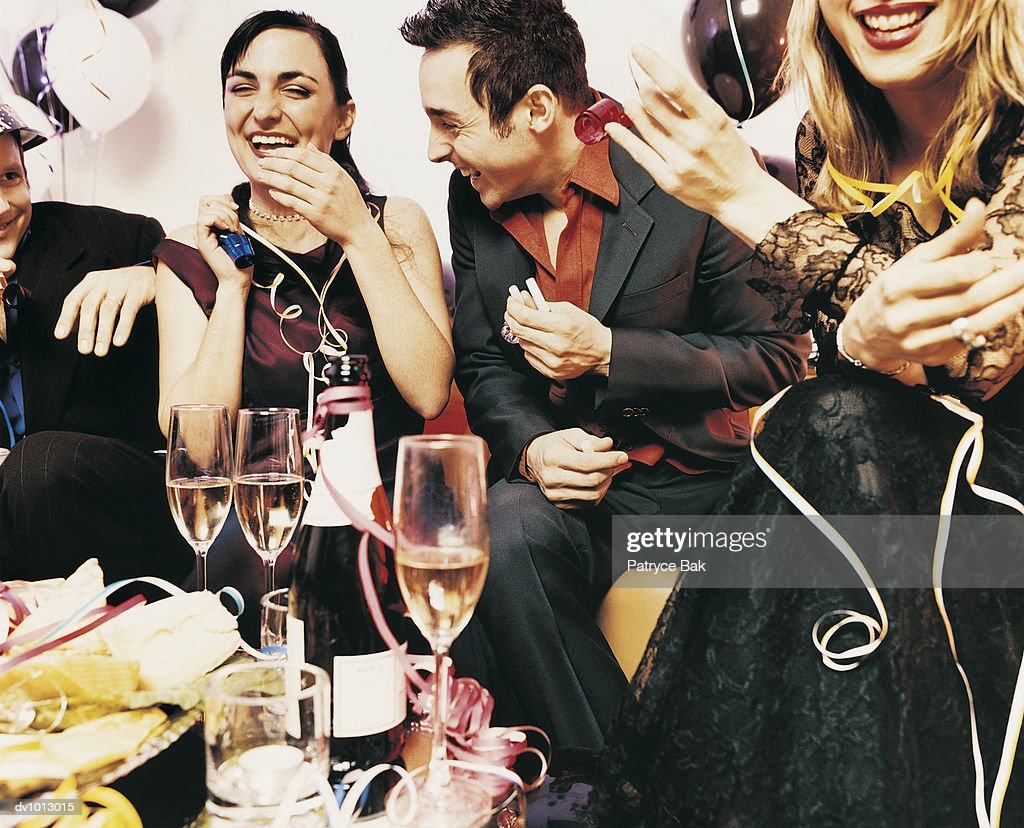 Couple Flirting With Each Other at a Party : Stock Photo