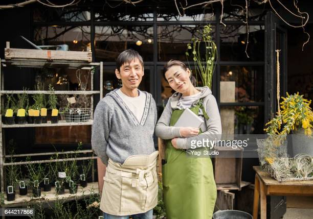 Couple florists working in flower shop