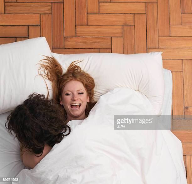 Couple fooling around in bed