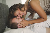 Couple foreplay in bed after waking up