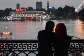 A couple gazes over the Nile River on Valentine's Day February 14 2011 in Cairo Egypt Although not a traditional holiday in Egypt globalization has...