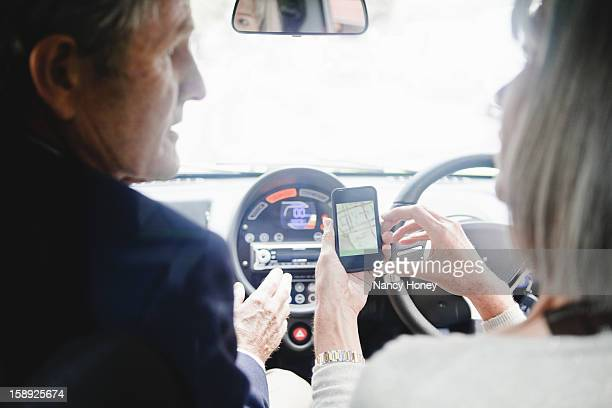 Couple getting directions on cell phone