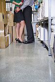 Couple Getting Intimate in Storage Room