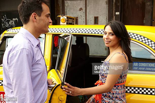 Couple getting into taxi together