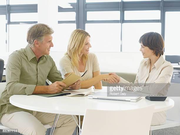 Couple greeting financial advisor