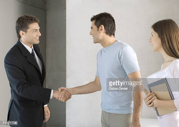 Couple greeting salesman