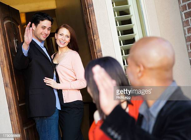 Couple Greeting Visitors
