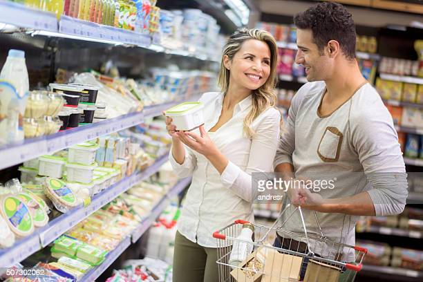 Couple grocery shopping at the food market