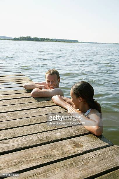 Couple hanging out by dock