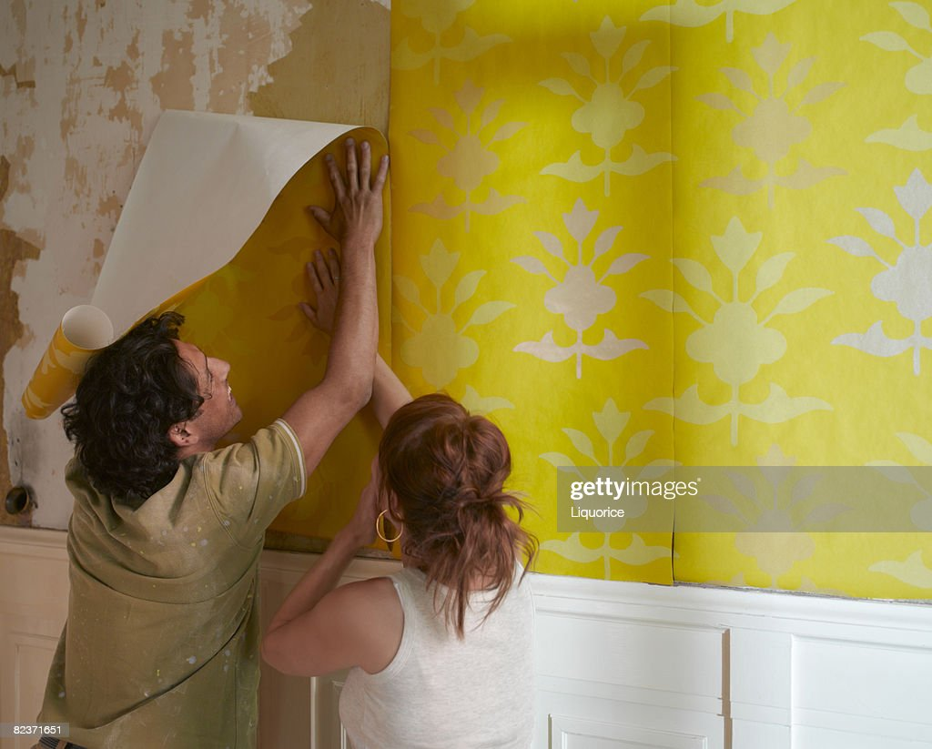 couple hanging wallpaper : Stock Photo