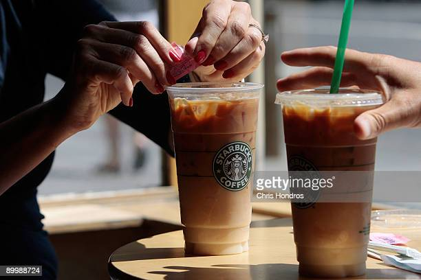 A couple has iced coffee drinks at a Starbucks Coffee shop in lower Manhattan August 21 2009 in New York City Starbucks America's dominant...
