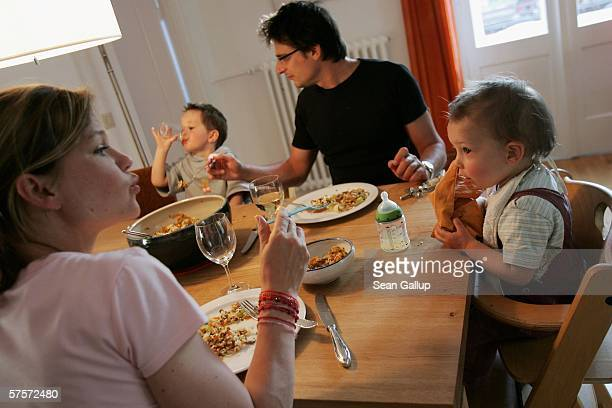 Kostas Kosmas and his wife Annette Wassermann have dinner at home with their sons Leander 16 months and Damian after work May 9 2006 in Berlin...