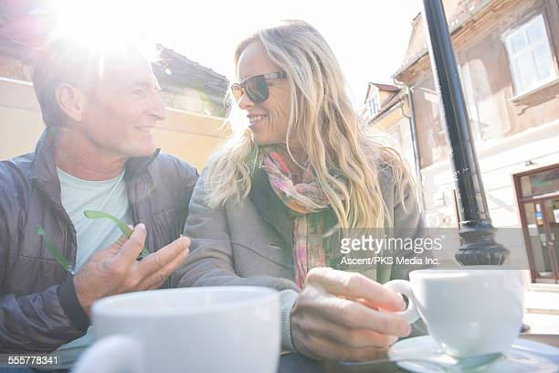 Couple have discussion at outdoor cafe