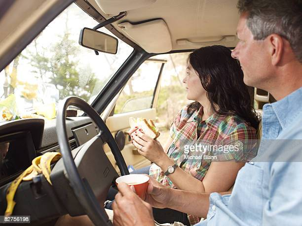 Couple have lunch in their car