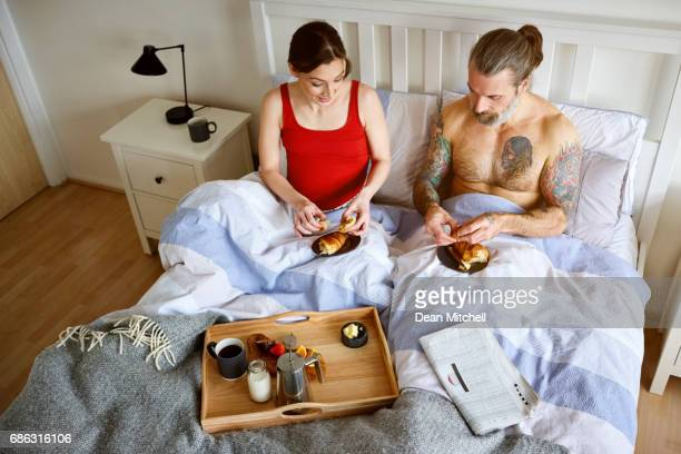 Couple having a breakfast in the bed