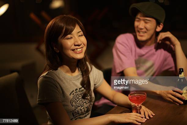 Couple Having a Drink in Bar