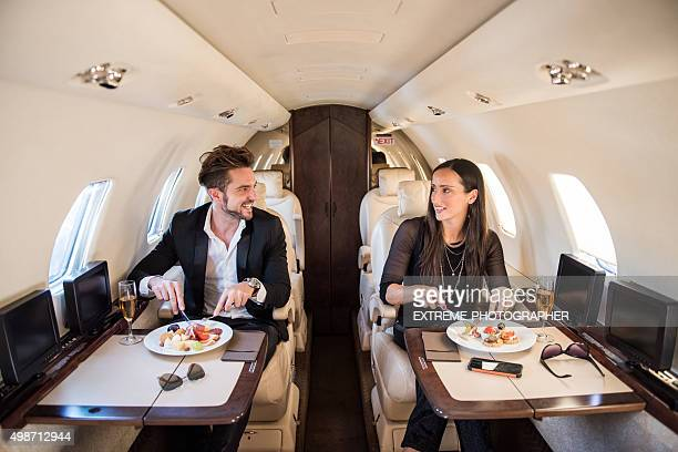 Couple having a meal in private jet airplane