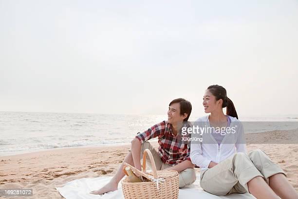 Couple Having a Romantic Picnic on the Beach