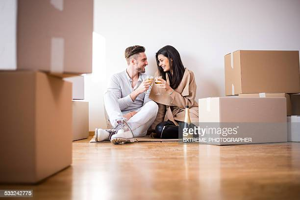 Couple having a toast in new apartment