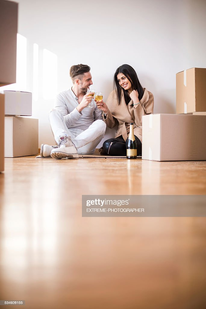 Couple having a toast on the floor