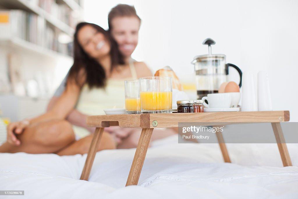 Couple having breakfast in bed : Stock Photo