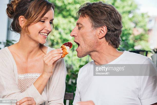 Couple having breakfast on balcony