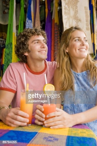Couple having cocktails at outdoor cafe : Stock Photo