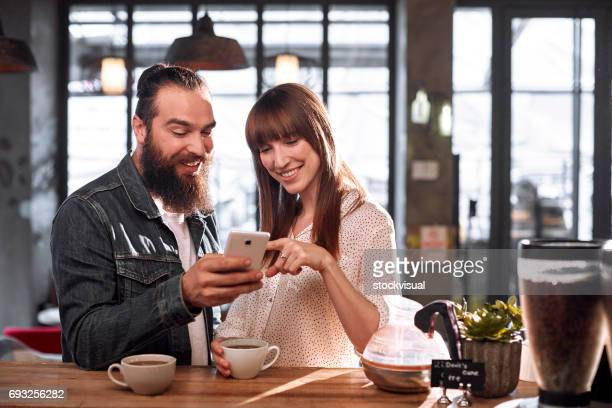 Couple having coffee at cafe