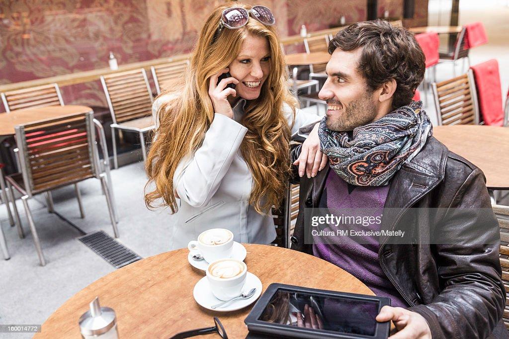 Couple having coffee at sidewalk cafe : Stock Photo