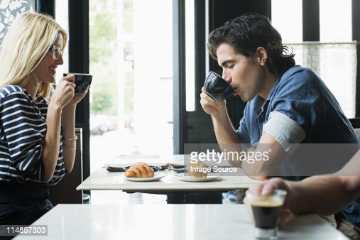 Couple having coffee in cafe : Stock Photo