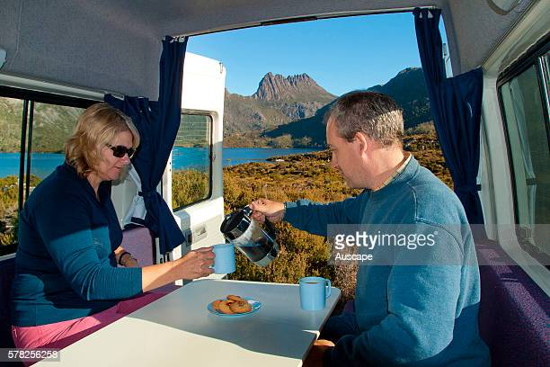 Couple having coffee in campervan Cradle MountainLake St Clair National Park Tasmania Australia