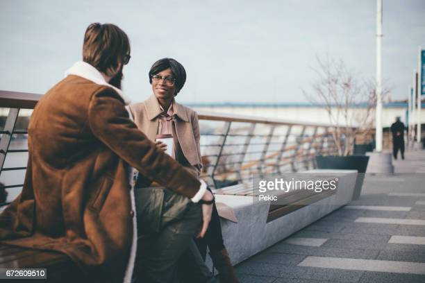 Couple having coffee in city on beautiful autumn day