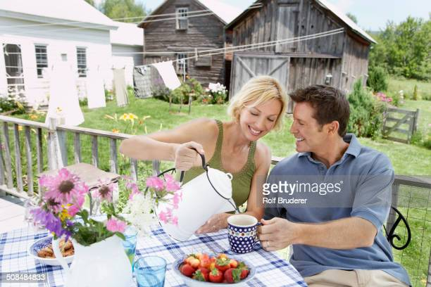 Couple having coffee on patio